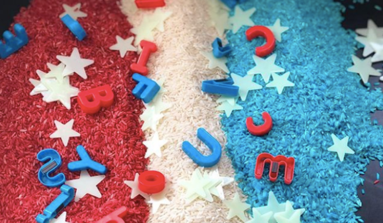 red, white, and blue rice with magnet letters and plastic stars